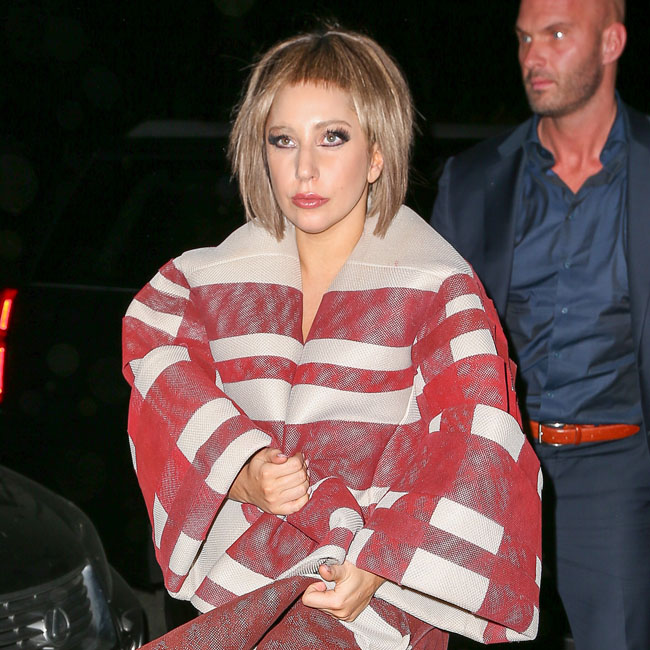 Lady Gaga spotted with a new look as she greets her fans while arriving at her apartment in New York City