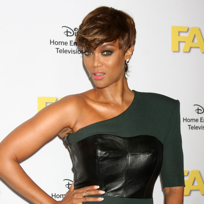 Model Tyra Banks rocks asymmetrical green dress with leather accents and side zipper  attends Disney ABC Television Group's 2015 TCA Summer Press Tour at the Beverly Hilton Hotel in Beverly Hills Pictured: Tyra Banks Ref: SPL1093581  050815   Picture by: @Parisa Splash News and Pictures Los Angeles:	310-821-2666 New York:	212-619-2666 London:	870-934-2666 photodesk@splashnews.com