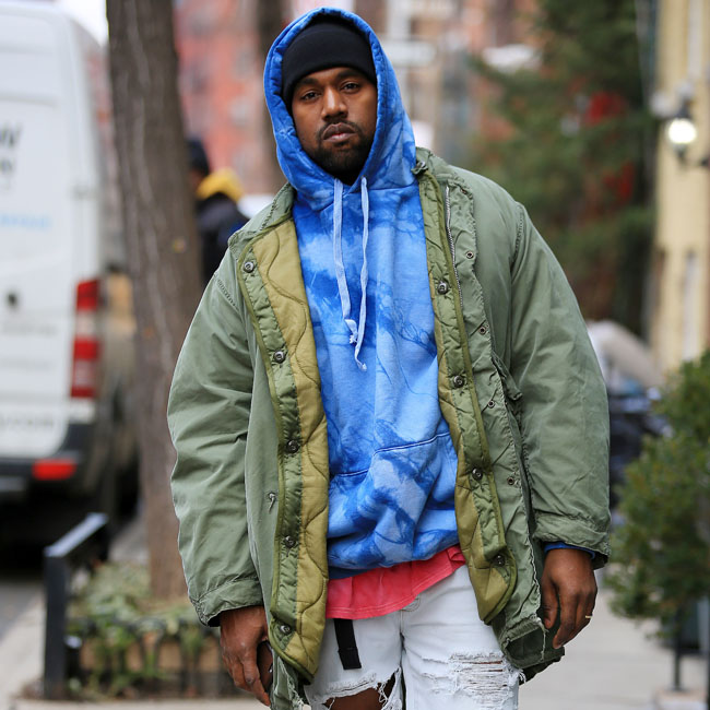 Kanye West poses for street photographs in West Village, NY Pictured: Kanye West Ref: SPL1223544  090216   Picture by: Jackson Lee / Splash News Splash News and Pictures Los Angeles:	310-821-2666 New York:	212-619-2666 London:	870-934-2666 photodesk@splashnews.com