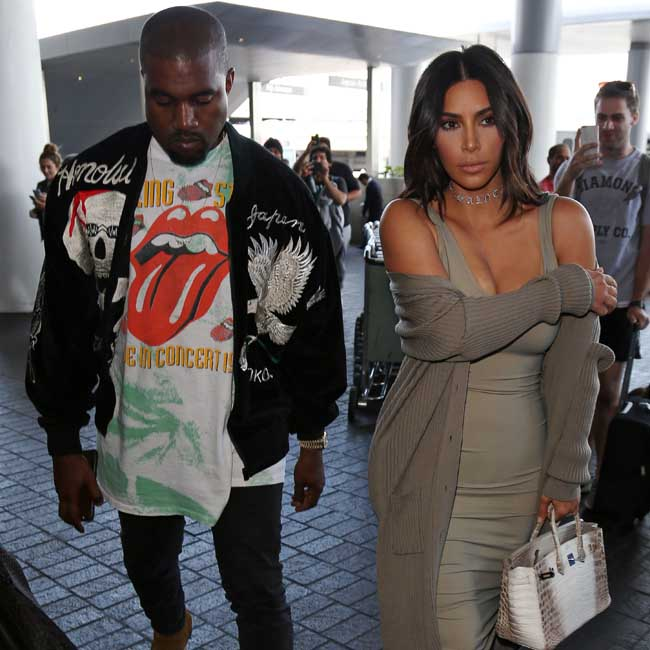 Kim Kardashian and Kanye West arrive at LAX Airport to catch a flight to France