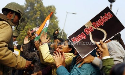 A demonstrator taunts the police during a protest in New Delhi/AFP