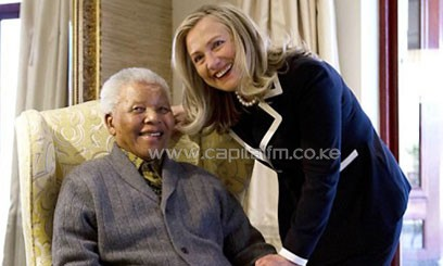 US Secretary of State Hillary Clinton meets Nelson Mandela at his home in South Africa on August 6, 2012/AFP