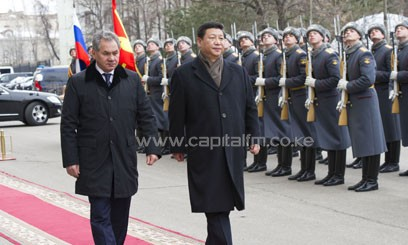 Chinese President Xi Jinping (R, Front) inspects the guard of honor together with Russian Defense Minister Sergei Shoigu/XINHUA
