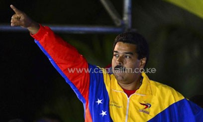 Venezuela's elected president Nicolas Maduro celebrates his victory in the polls in Caracas on April 14, 2013/AFP