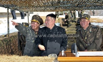 N.Korean leader Kim Jong-Un (C) observing a live fire drill at an undisclosed location in the country. N.Korea, incensed by the latest UN sanctions and South Korea-US military drills, has issued a series of apocalyptic threats of nuclear war in recent weeks/AFP
