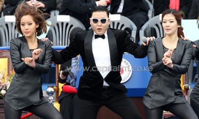 It shows Psy, wearing his signature sunglasses, dancing at various locations in and around Seoul/XINHUA-File
