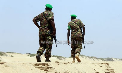 Kenyan soldiers from AU peacekeeping Mission in Somalia (AMISOM) walk along the sandy beaches in Kismayu/XINHUA-File