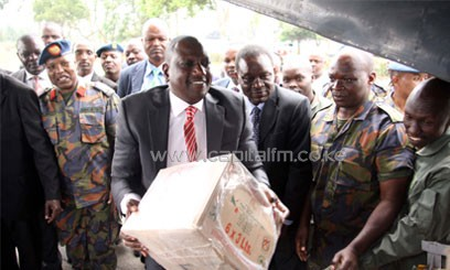 Deputy President William Ruto loading relief food airlifted to affected families last month. Photo/FILE.