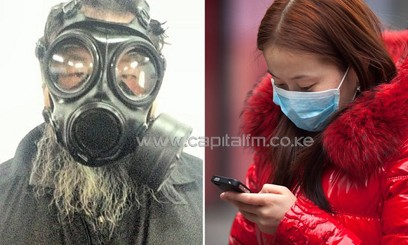 Chinese residents use masks to cover themselves from polluted air/FILE