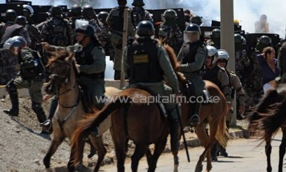 Riot police clash with protesters trying to block access to the Castelao Stadium/AFP