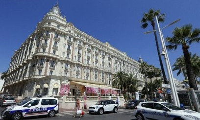 Police cars block the road outside the Carlton Hotel in the French Riviera resort of Cannes, July 28, 2013/AFP