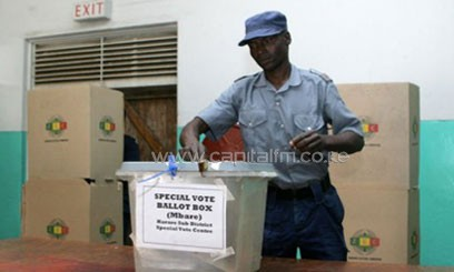 A police officer casts his ballot in Harare on July 14, 2013/AFP