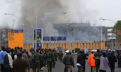 A crowd of onlookers outside the JKIA International Arrivals unit which caught fire on August 7/AFP