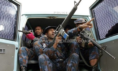 """File photo of Papua New Guinea police on patrol in the frontier town of Mount Hagen. An infamous cult leader known as """"Black Jesus"""", who was suspected of cannibalism, has been chopped to death in a remote Papua New Guinea village, reports said Friday/AFP"""