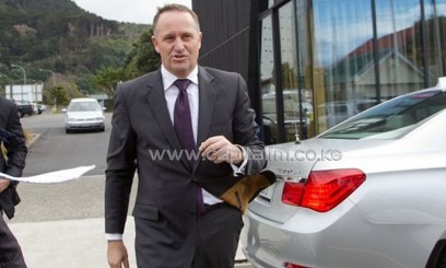 New Zealand Prime Minister John Key, pictured in Wellington, on July 22, 2013. Key said on Tuesday he will visit Beijing later this year to personally apologise to Chinese consumers over the Fonterra milk botulism scare/AFP