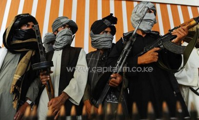Former Taliban fighters stand with their weapons during a ceremony after joining Afghan government forces in Herat on August 7, 2013/AFP