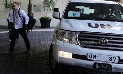 The UN chemical weapons investigation team arrives in Damascus on August 18, 2013/AFP
