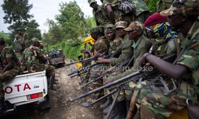 Trucks  full of M23 rebels drive towards Sake in eastern DR Congo on November 30, 2012/AFP