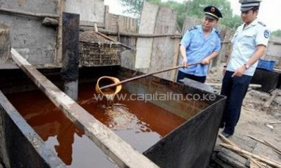 "Police inspect illegal cooking oil, better known as ""drainage oil"" seized during a crackdown in Beijing/AFP"