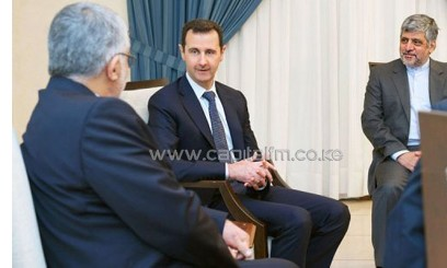 Picture released by the Syrian Arab News Agency on September 1, 2013 shows Syrian President Bashar al-Assad (C) with the Iranian parliament's security and foreign affairs head Aladin Borujerdi (L) in Damascus/AFP