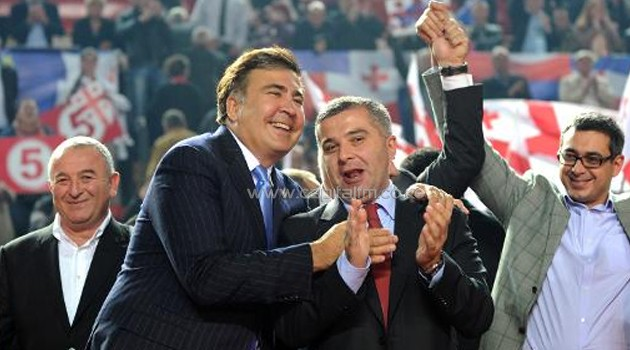 Georgia's President Mikheil Saakashvili (L) and presidential candidate of the United National Movement (UNM) party David Bakradze attend a campaign rally in Tbilisi on October 5, 2013/AFP