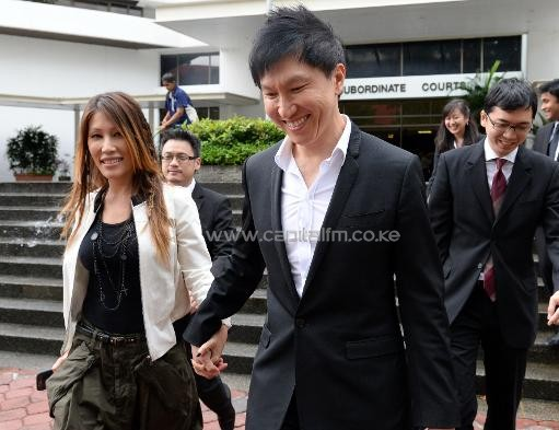 City Harvest Church founder Kong Hee and his pop-singer wife Ho Yeow Sun leave court in Singapore during his fraud trial on September 9, 2013/AFP