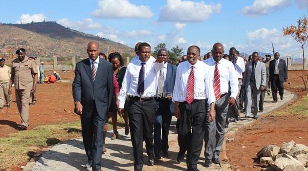 Machakos Governor Alfred Mutua with the President's Chief of Staff Joseph Kinyua tour the Machakos investment zone site/COURTESY