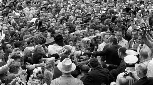 President John F. Kennedy is shown reaching out to the crowd in Fort Worth, Texas, hours before he died on November 22, 1963/AFP