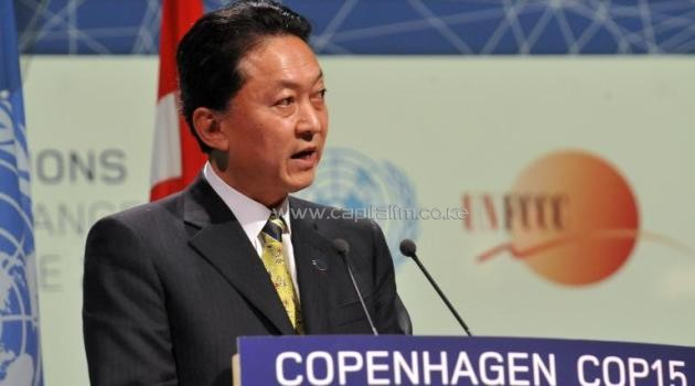 Japanese Prime Minister Yukio Hatoyama delivers a speech during a plenary session at the Bella center in Copenhagen, on December 18, 2009, on the 12th day of COP15 UN Climate Change Conference/AFP