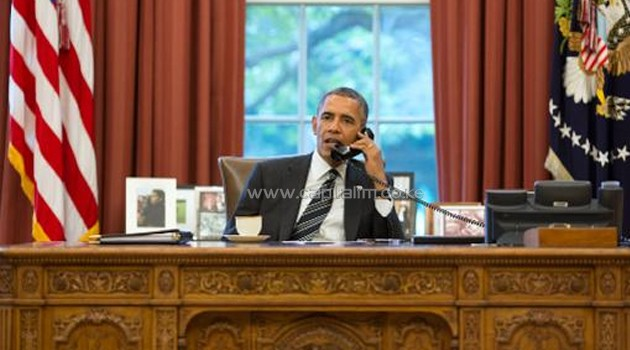 This official White House photograph released on September 27, 2013 shows President Barack Obama talks with President Hassan Rouhani of Iran during a phone call in the Oval Office/AFP