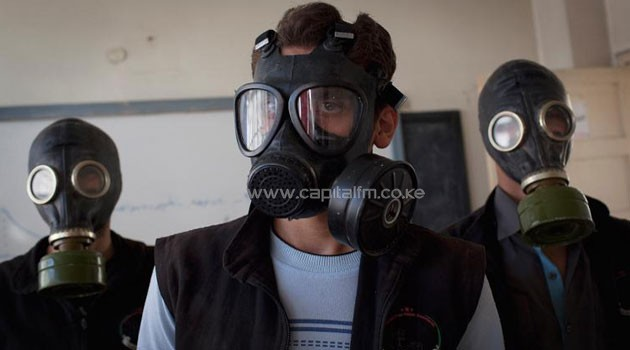 Volunteers wear gas masks during a class on how to respond to a chemical attack, in the northern Syrian city of Aleppo on September/AFP