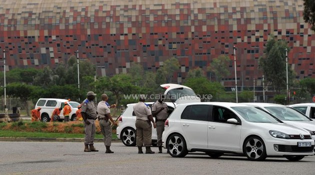 Police check a car near Soccer City stadium - also known as FNB stadium - in Soweto, outside Johannesburg, on December 9, 2013 ahead of the memorial service for former South African former president Nelson Mandela's Tuesday  © AFP Alexander Joe