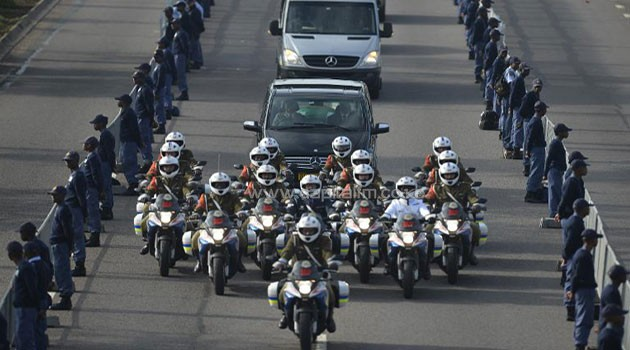 The funeral cortege of former South African president Nelson Mandela leaves the 1 Military Hospital in Pretoria on December 11, 2013 for the Union Buildings marking the start of a three-day lying in state/AFP