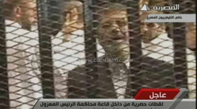 Image grab taken from Egyptian state TV shows ousted Egyptian president Mohamed Morsi in court in Cairo on November 4, 2013/AFP