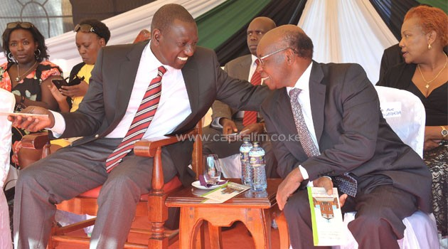 Deputy President William Ruto and Dr S.K Macharia Royal Media Services Chairman during the fundraising for 21 churches in Uasin Gishu County. PICTURE REBECCA NDUKU/DPPS
