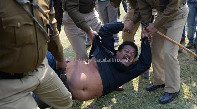 A demonstrator demanding a separate state of Telangana is detained by Indian policemen/AFP