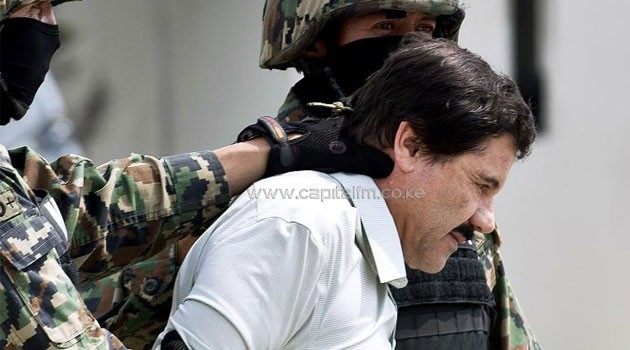 "Mexican drug trafficker Joaquin Guzman Loera, aka ""el Chapo Guzman"", is escorted by marines on February 22, 2014 in Mexico City © AFP"
