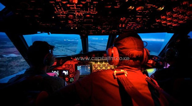 Crew members on board an RAAF AP-3C Orion during an 11 hour search mission for missing Malaysia Airways flight MH370, March 24, 2014  © POOL/AFP