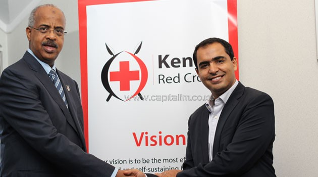 Kenya Red Cross Secretary General Abbas Gullet (L) and Airtel Kenya MD Adil El Youssefi at the Kenya Red Cross offices/COURTESY