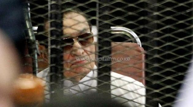 Former Egyptian president Hosni Mubarak is seen behind bars during his retrial in Cairo on August, 25 2013/AFP
