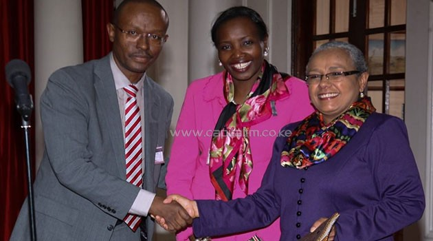 "First Lady Margaret Kenyatta receives a cheque worth  Sh2 million from Miller Foundation (K) Chairperson, Cecil Miller, to go toward the ""Beyond Zero"" campaign/PSCU"