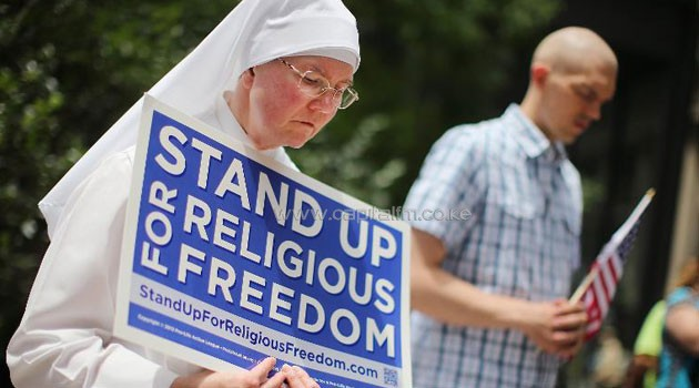 A rally with supporters of religious freedom to praise the Supreme Court's decision in the Hobby Lobby contraception coverage requirement case on June 30, 2014 in Chicago, Illinois/AFP