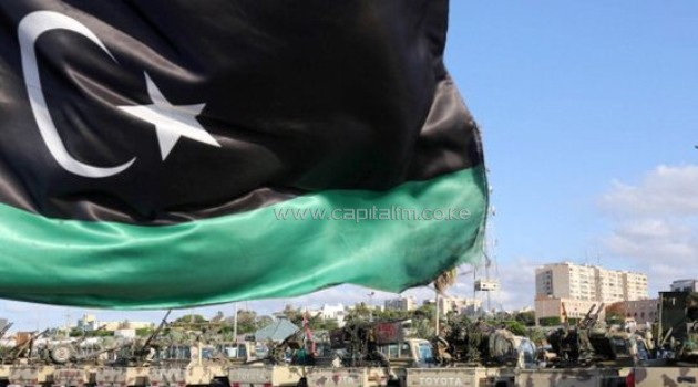 The National Flag Flutters As Libyan Security Gather In The Capital Tripoli/AFP