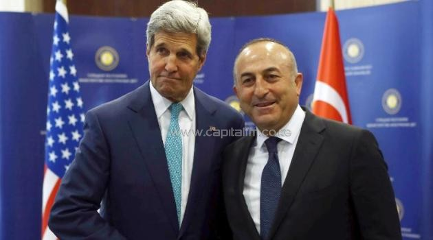 US Secretary of State John Kerry (L) and Turkey's foreign minister Mevlut Cavusoglu shake hands prior to their meeting at the Ministry of Foreign Affairs on September 12, 2014 in Ankara/AFP