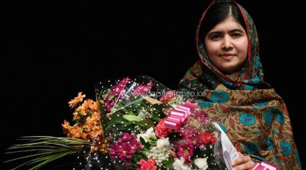 "Pakistani rights activist Malala Yousafzai said she was ""honoured"" to win the Nobel Peace Prize after addressing the media in Birmingham, on October 10, 2014/AFP"