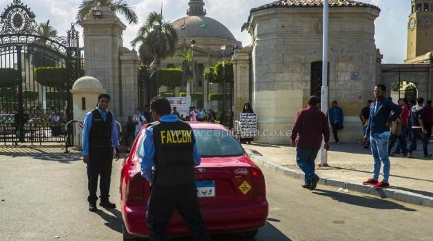 Egyptian security guards from a private company search a car at the gates of Cairo University in the Egyptian capital on October 11, 2014, as students arrive for the first day of the new academic year/AFP