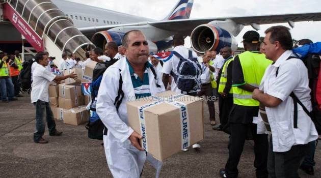 The first members of a team of 165 Cuban doctors and health workers unload boxes of medicines and medical material from a plane upon their arrival at Freetown's airport to help the fight against Ebola in Sierra Leone on Thursday/AFP