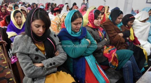 Pakistani Christians pray for the victims of the Peshawar school massacre at St. John's Cathedral in Peshawar on December 21, 2014/AFP