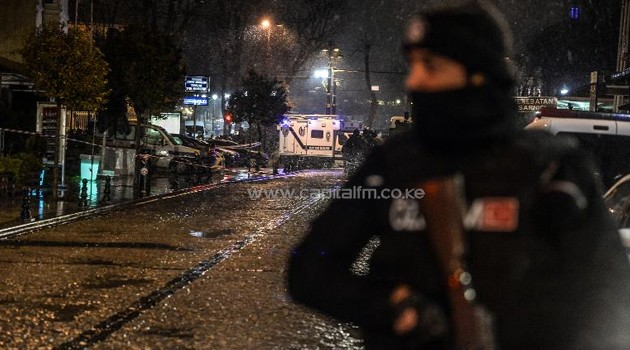 A Turkish police officer stands guard along a street leading to where a female suicide bomber was killed on January 6, 2015, when she blew herself up in an attack on the police station in the main tourist district of Istanbul/AFP