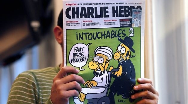 The front cover of French satirical weekly Charlie Hebdo which features cartoons of a nude Prophet Mohammed/AFP